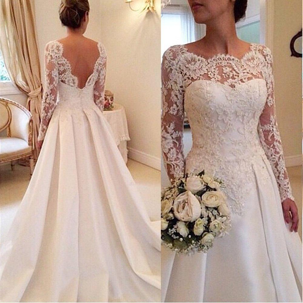 Свадебные платья с кружевами на подоле
